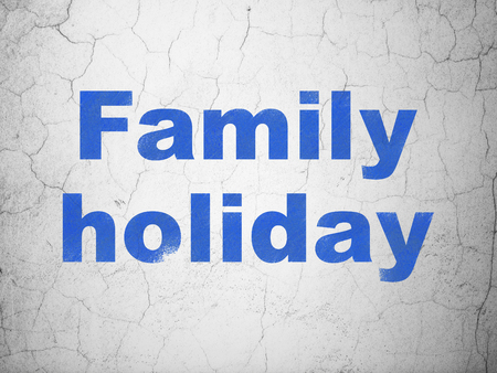 family holiday: Vacation concept: Blue Family Holiday on textured concrete wall background