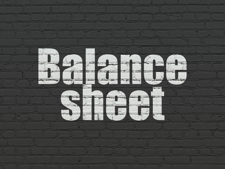 sheet: Currency concept: Painted white text Balance Sheet on Black Brick wall background