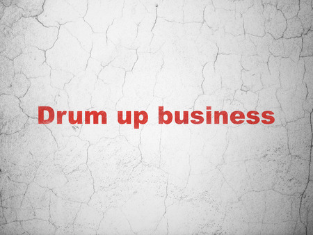 red drum: Business concept: Red Drum up business on textured concrete wall background