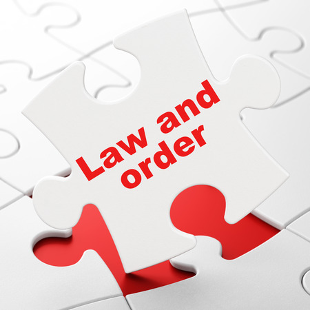 brainteaser: Law concept: Law And Order on White puzzle pieces background, 3D rendering