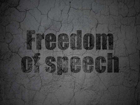 dictatorship: Politics concept: Black Freedom Of Speech on grunge textured concrete wall background