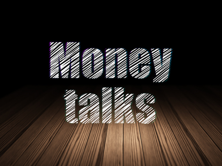 conversaciones: Business concept: Glowing text Money Talks in grunge dark room with Wooden Floor, black background Foto de archivo