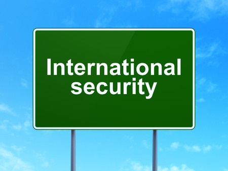 international security: Security concept: International Security on green road highway sign, clear blue sky background, 3D rendering