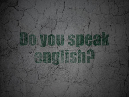 speak english: Education concept: Green Do you speak English? on grunge textured concrete wall background