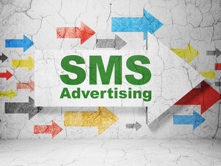 sms: Advertising concept:  arrow with SMS Advertising on grunge textured concrete wall background, 3D rendering