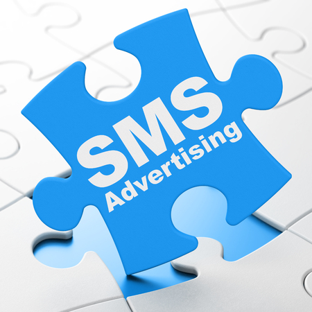 sms: Marketing concept: SMS Advertising on Blue puzzle pieces background, 3D rendering