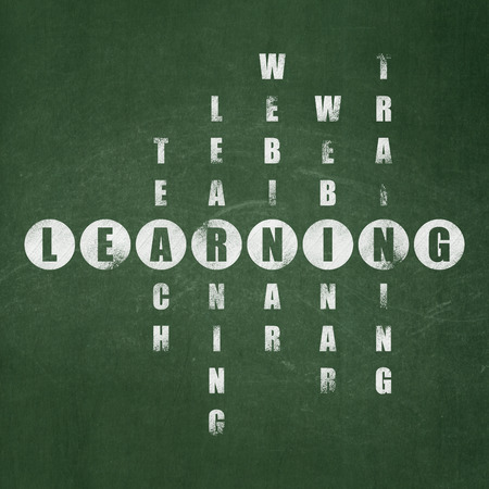 crossword: Learning concept: Painted White word Learning in solving Crossword Puzzle on School board background, School Board