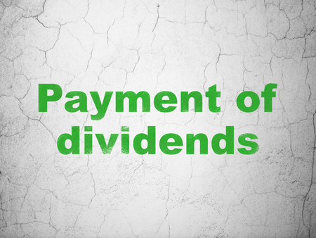 dividends: Money concept: Green Payment Of Dividends on textured concrete wall background
