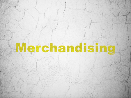 merchandising: Marketing concept: Yellow Merchandising on textured concrete wall background Stock Photo