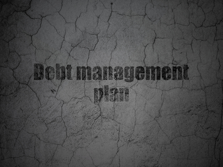 debt management: Business concept: Black Debt Management Plan on grunge textured concrete wall background Stock Photo