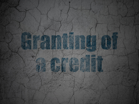granting: Currency concept: Blue Granting of A credit on grunge textured concrete wall background