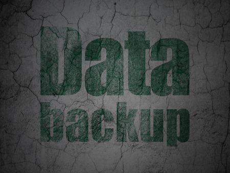data backup: Data concept: Green Data Backup on grunge textured concrete wall background Stock Photo