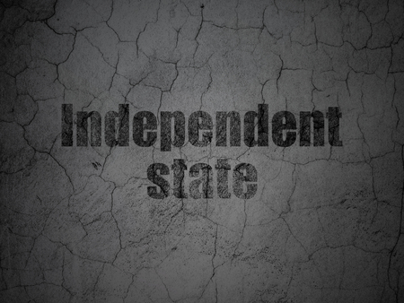 independent: Politics concept: Black Independent State on grunge textured concrete wall background