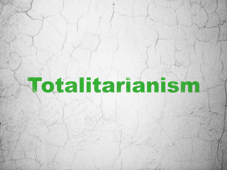totalitarianism: Politics concept: Green Totalitarianism on textured concrete wall background
