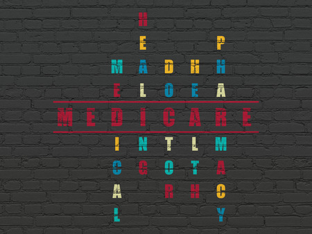 medicare: Healthcare concept: Painted red word Medicare in solving Crossword Puzzle Stock Photo
