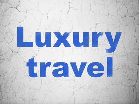 luxury travel: Vacation concept: Blue Luxury Travel on textured concrete wall background