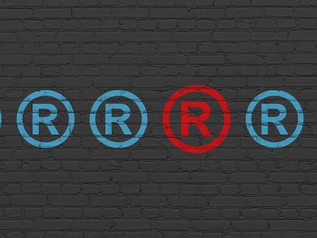 r regulation: Law concept: row of Painted blue registered icons around red registered icon on Black Brick wall background Stock Photo