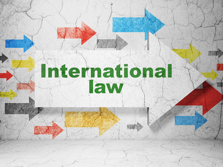 international law: Politics concept:  arrow with International Law on grunge textured concrete wall background, 3D rendering