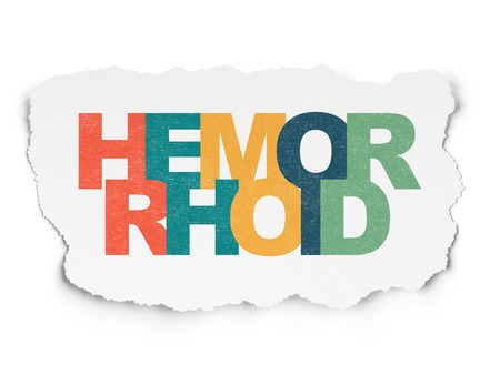 hemorrhoid: Healthcare concept: Painted multicolor text Hemorrhoid on Torn Paper background