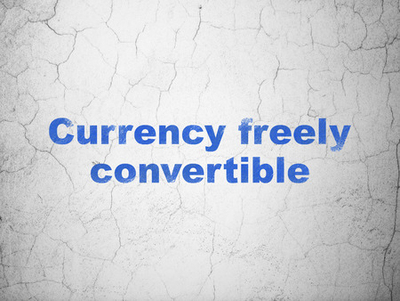 freely: Currency concept: Blue Currency freely Convertible on textured concrete wall background