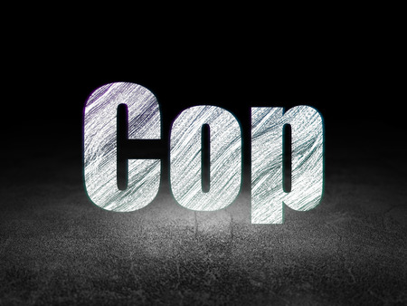 Law concept: Glowing text Cop in grunge dark room with Dirty Floor, black background Stock Photo