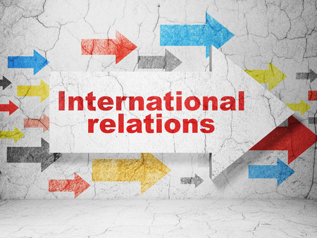 relations: Political concept:  arrow with International Relations on grunge textured concrete wall background, 3D rendering