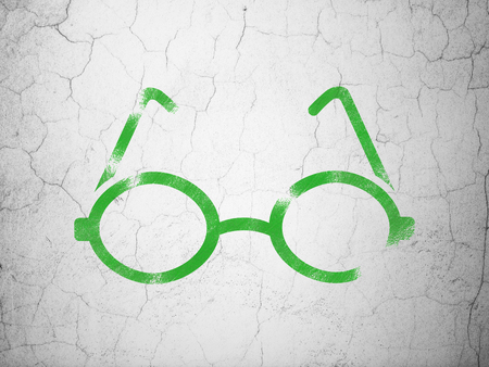 green glasses: Studying concept: Green Glasses on textured concrete wall background