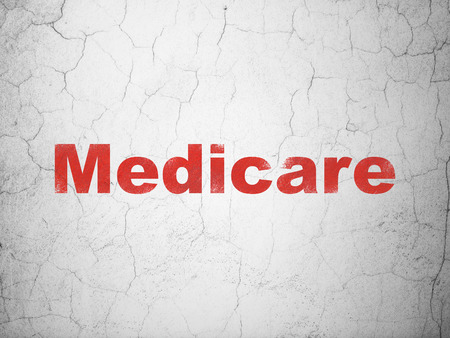 medicare: Health concept: Red Medicare on textured concrete wall background