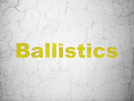 Science concept: Yellow Ballistics on textured concrete wall background Stock Photo
