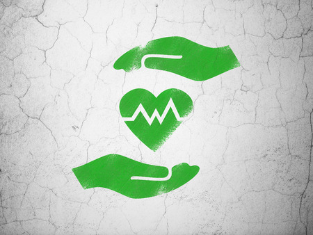 green heart: Insurance concept: Green Heart And Palm on textured concrete wall background