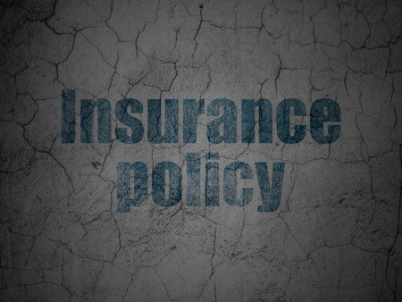 insurance policy: Insurance concept: Blue Insurance Policy on grunge textured concrete wall background