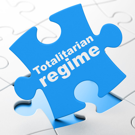 brainteaser: Political concept: Totalitarian Regime on Blue puzzle pieces background, 3D rendering Stock Photo