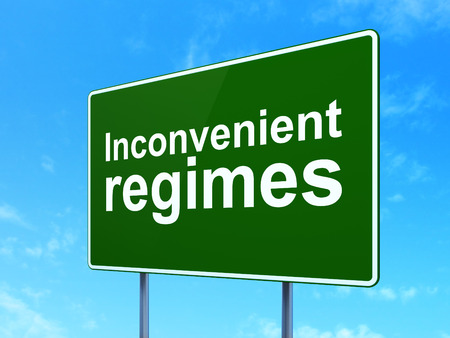 inconvenient: Political concept: Inconvenient Regimes on green road highway sign, clear blue sky background, 3D rendering Stock Photo