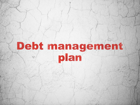 debt management: Business concept: Red Debt Management Plan on textured concrete wall background