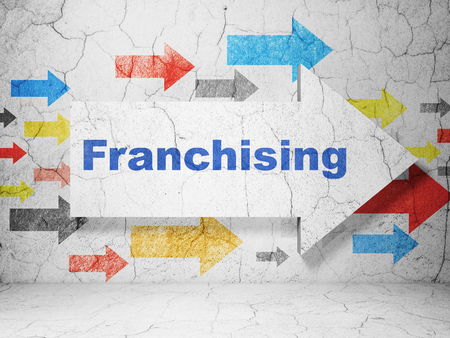 franchising: Business concept:  arrow with Franchising on grunge textured concrete wall background, 3D rendering