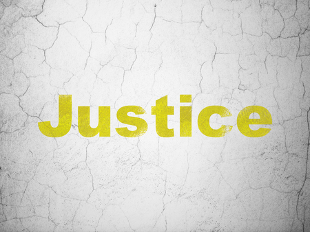 criminal act: Law concept: Yellow Justice on textured concrete wall background