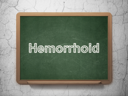 hemorrhoid: Health concept: text Hemorrhoid on Green chalkboard on grunge wall background, 3D rendering