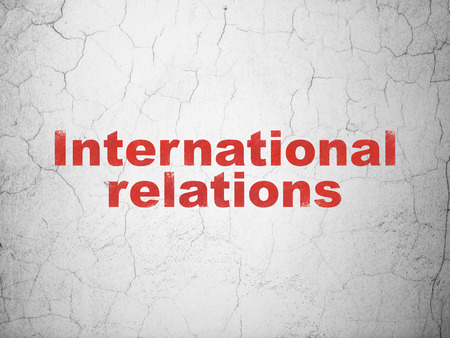 relations: Politics concept: Red International Relations on textured concrete wall background