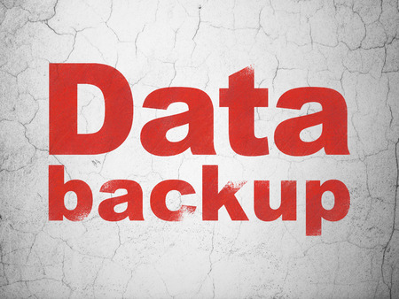data backup: Data concept: Red Data Backup on textured concrete wall background