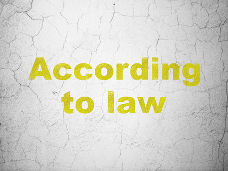 according: Law concept: Yellow According To Law on textured concrete wall background