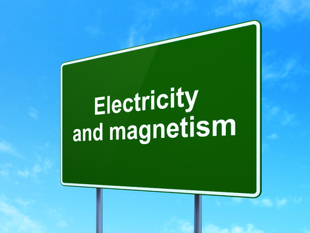 magnetismo: Science concept: Electricity And Magnetism on green road highway sign, clear blue sky background, 3D rendering