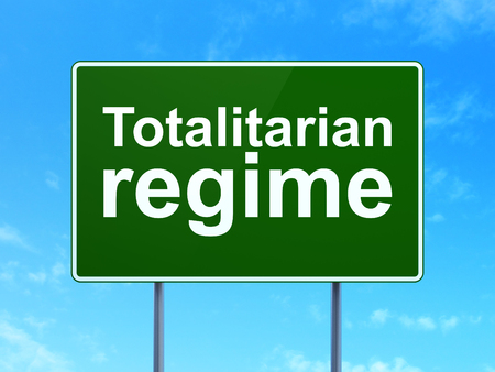 totalitarian: Politics concept: Totalitarian Regime on green road highway sign, clear blue sky background, 3D rendering Stock Photo