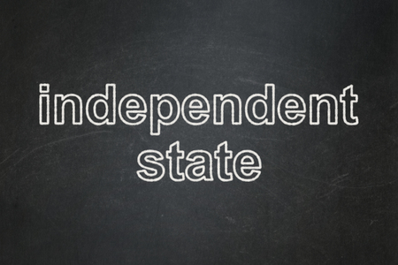 independent: Politics concept: text Independent State on Black chalkboard background Stock Photo