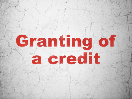 granting: Banking concept: Red Granting of A credit on textured concrete wall background