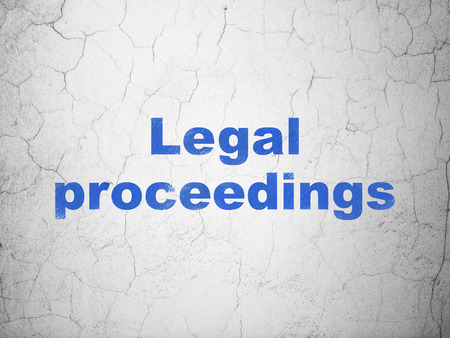 Law concept: Blue Legal Proceedings on textured concrete wall background Stock Photo