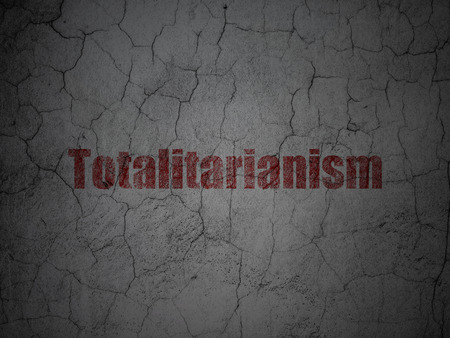 totalitarianism: Politics concept: Red Totalitarianism on grunge textured concrete wall background