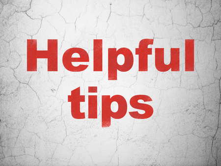helpful: Education concept: Red Helpful Tips on textured concrete wall background