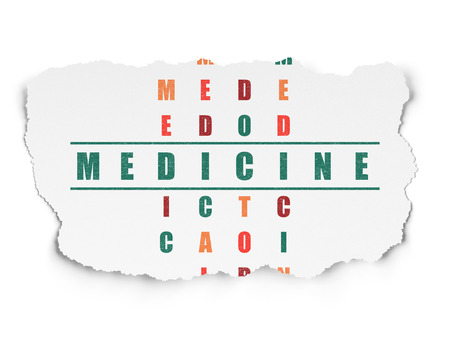word medicine: Healthcare concept: Painted green word Medicine in solving Crossword Puzzle on Torn Paper background