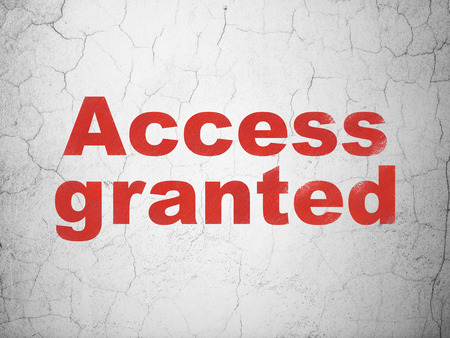 granted: Protection concept: Red Access Granted on textured concrete wall background