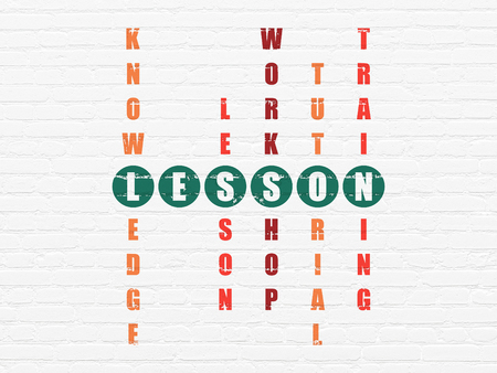 word lesson: Learning concept: Painted green word Lesson in solving Crossword Puzzle Stock Photo